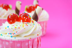 Cupcake on pink background. Royalty Free Stock Photo