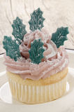 Cupcake with pink butter cream and leaves Royalty Free Stock Photo