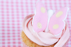 Cupcake with pink butterfly Stock Images