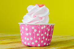 Cupcake. Pink Cupcake on color background Stock Photo