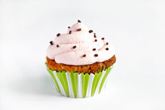 Cupcake with pink cream icing,  on white background Royalty Free Stock Image