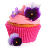Cupcake with   pink cream and  violets Stock Photography