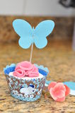 Cupcake with Pink Flower and Butterfly Stock Photo