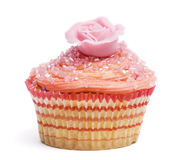 Cupcake with pink flower decoration against white background Royalty Free Stock Photo