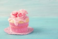 Cupcake with pink flowers royalty free stock image