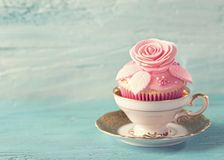 Cupcake with pink flowers. Cupcakes with pink flowers. Retro vintage still life stock photos