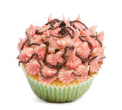 Cupcake with pink icing against white background Stock Photography