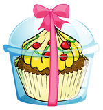 A cupcake with a pink ribbon Royalty Free Stock Image
