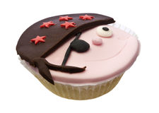 Cupcake with pirate face isolated over white Royalty Free Stock Photography