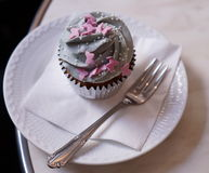 Cupcake on plate in coffee Royalty Free Stock Image
