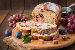 Cupcake with plums and grapes. Stock Image