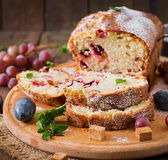 Cupcake with plums and grapes. Stock Photos