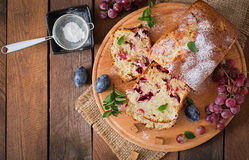 Cupcake with plums and grapes. Top view Royalty Free Stock Photo