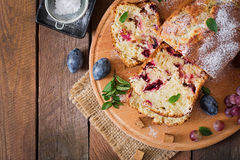 Cupcake with plums and grapes. Top view Royalty Free Stock Photography