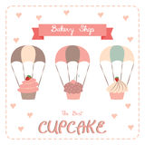 Cupcake poster design. Cute sweet cupcakes on parachute. Vector illustration isolated elements for bakery Stock Photography