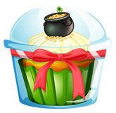 A cupcake with a pot of coins Stock Photo