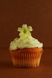 Cupcake with primrose flower on top Stock Photos