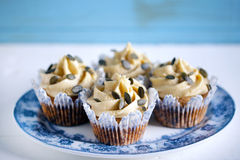 Cupcake with pumpkin buttercream icing and seeds, close-up Stock Photography