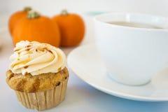 Cupcake and pumpkins and tea Royalty Free Stock Photos