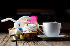 Cupcake and rabbit toy with cup of coffee Stock Photos