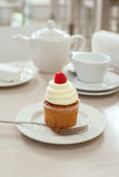 A cupcake with raspberry Royalty Free Stock Image