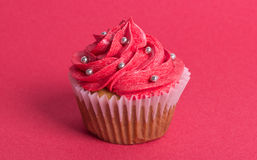 Cupcake on red background royalty free stock photos