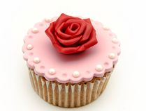 Cupcake with a red flower Royalty Free Stock Images