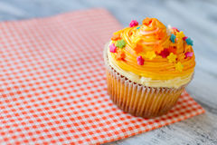 Cupcake on red napkin. Stock Images