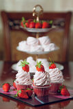 Cupcake. Red velvet with strawberry front view stock photos