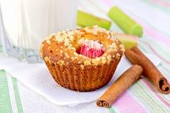 Cupcake with rhubarb and milk on linen napkin Stock Image