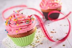 Cupcake and ribbon Stock Photos