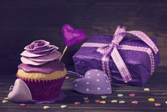 Cupcake with rose and a present Royalty Free Stock Image