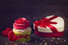 Cupcake with rose and a present Stock Image