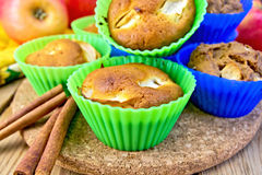 Cupcake and rye with apples on board Royalty Free Stock Image