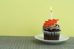 Cupcake on a Saucer with a Candle Stock Photos