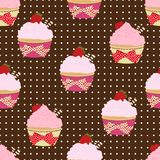 Cupcake seamless pattern, vector background. Cakes with pink fruit cream, with a cherry on top and waffles on a brown backdrop wit. H polka dots. Painted dessert Royalty Free Stock Image