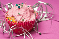 Cupcake with silver ribbon Royalty Free Stock Images