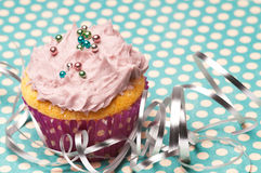 Cupcake with silver ribbon Royalty Free Stock Image