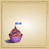 Cupcake with small flag. Place for text. Royalty Free Stock Photography