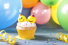 Cupcake with smile candles royalty free stock photography