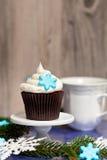 Cupcake with snowflake. Christmas theme. Cupcake with snowflake shaped sugar Stock Photo