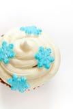 Cupcake with snowflake. Macro. Christmas theme. Cupcake with snowflake shaped sugar Stock Photo