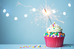 Cupcake with sparkler. Colorful cupcake with a sparkler stock images