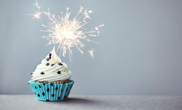 Cupcake with a sparkler Royalty Free Stock Images