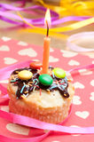 Cupcake with sprinkles and candle Stock Photo