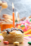 Cupcake with sprinkles and candle Stock Image