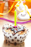 Cupcake with sprinkles and candle Royalty Free Stock Image