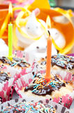 Cupcake with sprinkles and candle Stock Photography