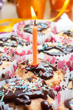 Cupcake with sprinkles and candle Stock Photos