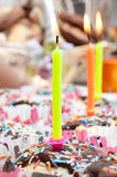 Cupcake with sprinkles and candle Royalty Free Stock Photos